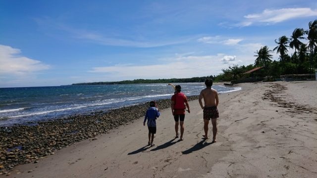 three men in the beach